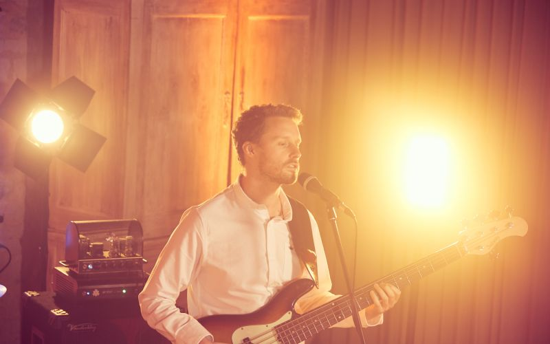 Singer with party lighting at a barn wedding venue in Surrey